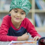 child-cancer-patient-reading_G_655603792