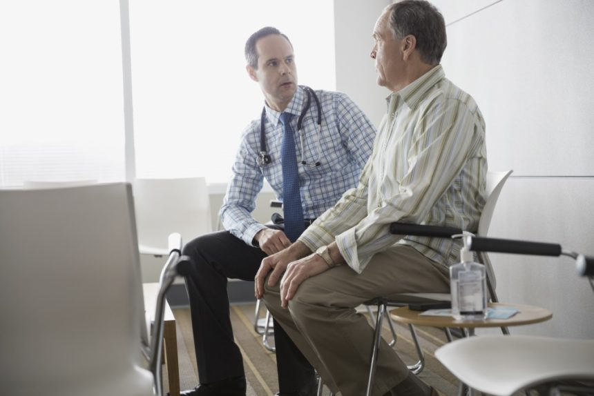 Clinician consulting with a patient