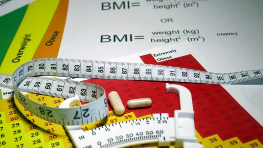 tape measure and BMI calculator