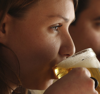 Drinking at least five beers per week raised a woman's risk of psoriasis.