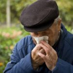 Older-man-blows-nose_G_148392545