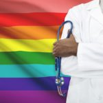 LGBT pride flag and a doctor in front