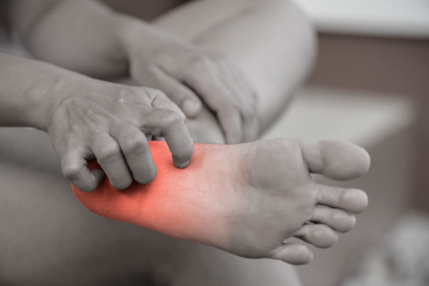 Chemotherapy-induced peripheral neuropathy (CIPN), characterized by pain, numbness, and tingling.