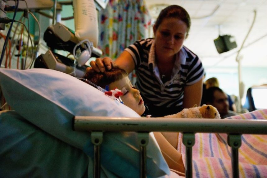 A child in a hospital bed