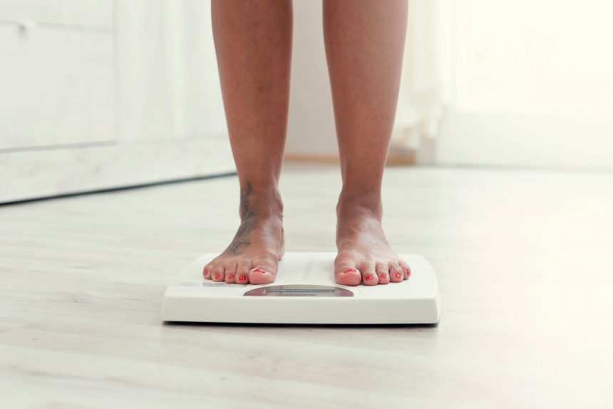 woman standing on scale