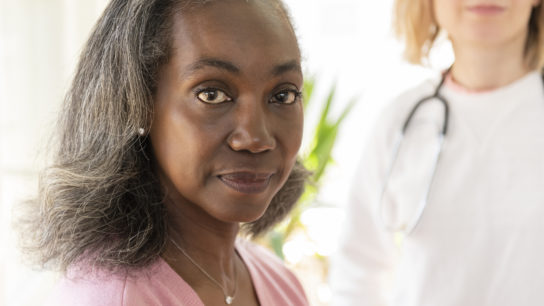 African American black woman female patient with White doctor