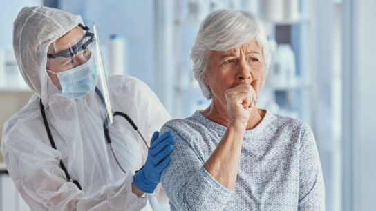 Doctor and older woman with COVID-19